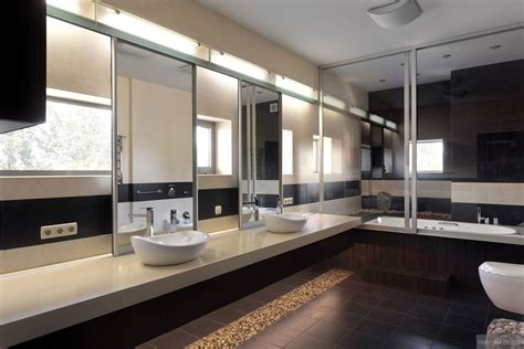 his and hers sinks in modern mirrored bathroom with
