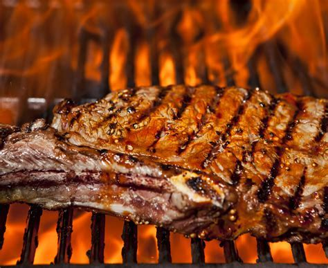 A top sirloin steak flame broiled on a barbecue, shallow