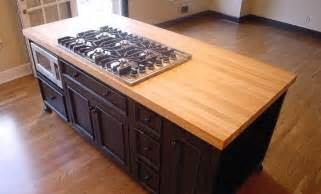 maple wood island countertop with cooktop cutout jpg