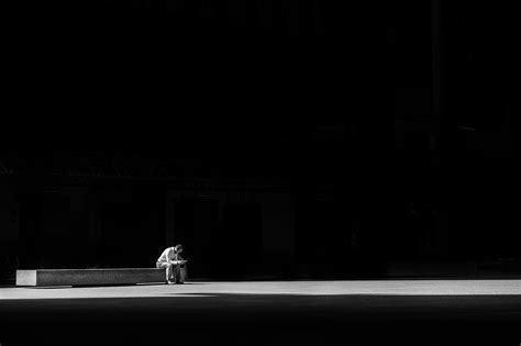 benching alone picture of man alone in darkness free stock photo