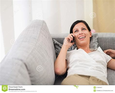 laying couch smiling woman laying on sofa and speaking mobile royalty