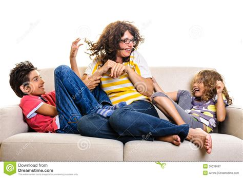 the last mama on the couch play family playing on sofa royalty free stock photography