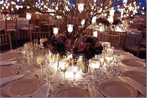 Diy wedding centerpieces floating candles with red orange rose and red seeds as well as