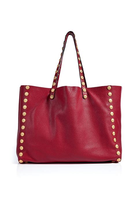 Valentino Studed valentino studded tote in lyst