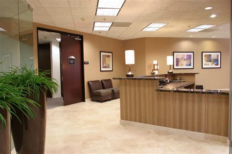 layout of office reception area brown color chairs in medical office waiting room design