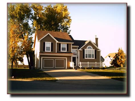 haus braun atlas coatings construction exterior repaint brown house