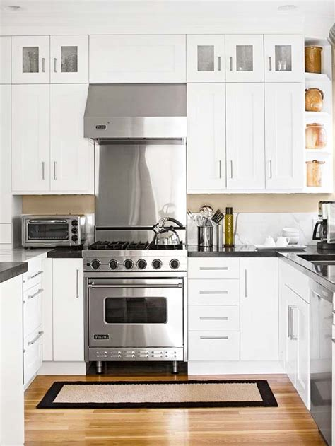 white kitchen cabinets with black countertops black countertops and white cabinets transitional kitchen bhg