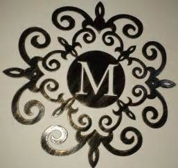 family initial monogram inside a metal scroll with m