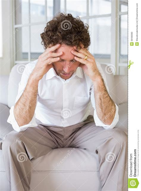 handson sofa worried well dressed man sitting with head in hands on