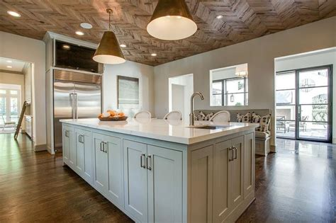 tv above refrigerator kitchen ideas pinterest wood herringbone ceiling transitional kitchen