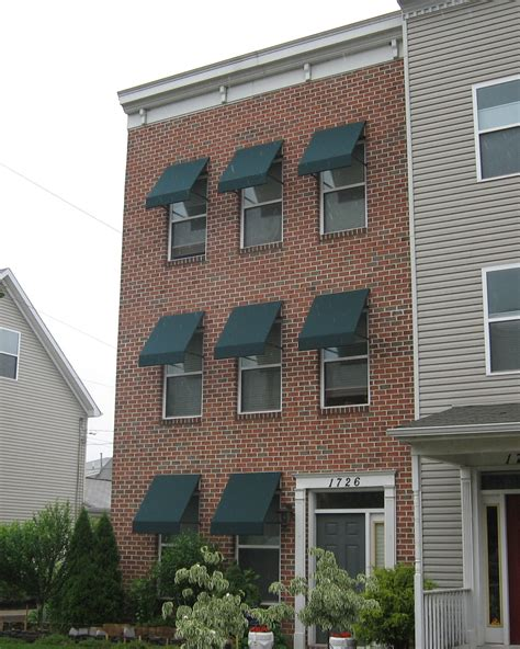 Canvas Window Awnings For Home by Welded Frame Window Awnings On A Brick Home Kreider S