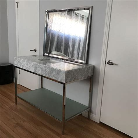 mid century modern marble bathroom vanity with chrome