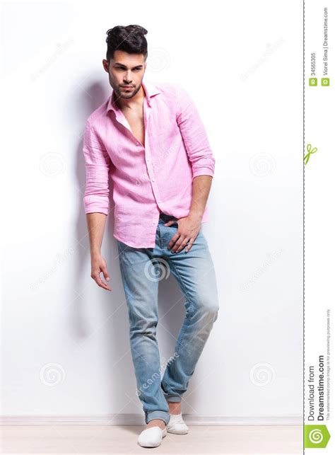 young fashion man holds hand at crotch stock image image