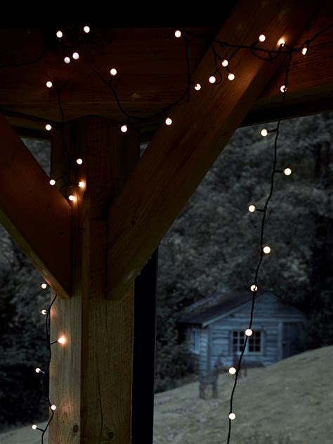 make your garden festive with lighting ideas from cox