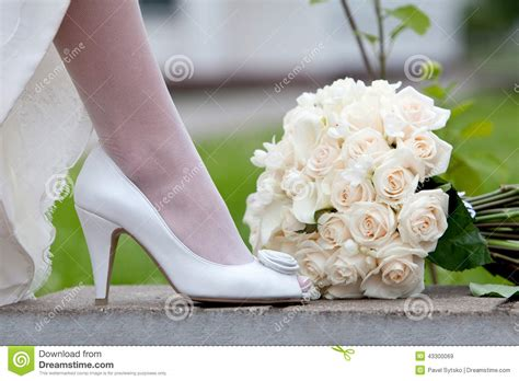 Releases Intimate Footage Of Wedding Celebrations As She Pays Tribute To Family by Wedding Shoe And Bridal Bouquet In White