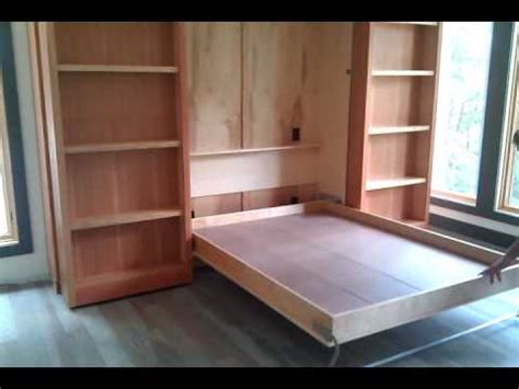 murphy bed wall unit with desk murphy bed wall bed hidden behind two bookshelves that