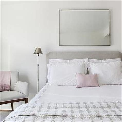 mirror above headboard heather gray headboard with white and pink hotel bedding
