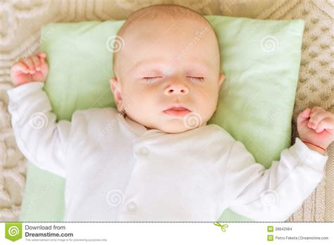 pillow for baby to sleep in bed cute newborn baby sleeping in bed stock images image