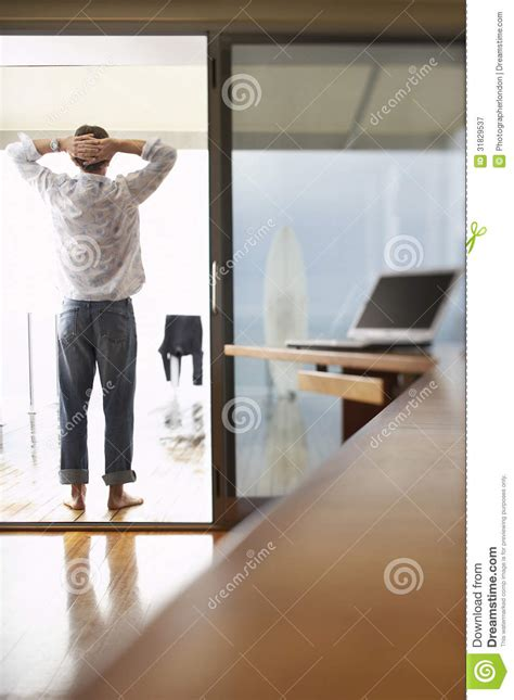 relaxed businessman standing  balcony royalty  stock