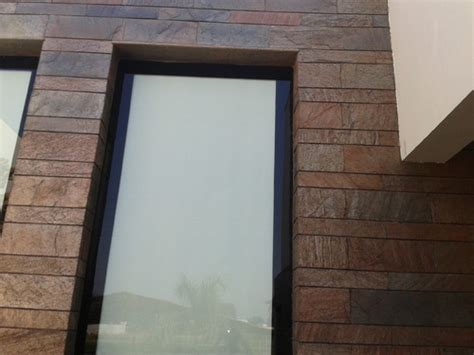 brown stone tile indian home front design with glass exporter of front elevation stone tiles from choice stone