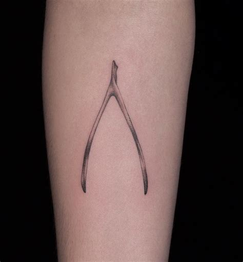 wishbone tattoo the best lucky tattoos insider