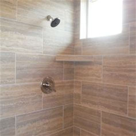 tub surround  installed  porcelain tile   brick pattern   glass tile insert