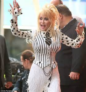does dolly parton have tattoos dolly parton denies arms are covered in tattoos