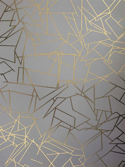 grey and gold angles wallpaper by british designer erica wakerly
