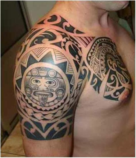 chest and shoulder tribal tattoos black ink maori tribal on chest and right shoulder