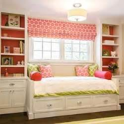 window daybed full sized day bed under windows with book shelves on