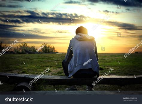 lonely man on bench lonely man sit on bench sunset stock photo 478443322