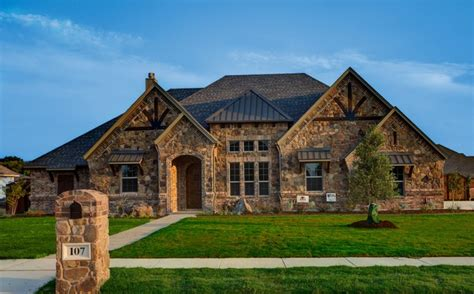 custom home designer bailee custom homes rustic exterior dallas by q