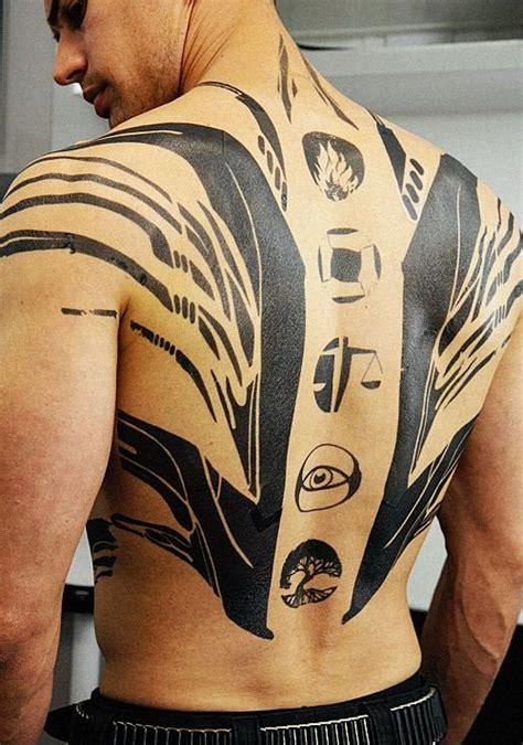 full back tattoo that has a tattoo com