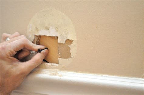Filling Holes In Ceiling Plasterboard by Diy Home Projects How To Repair Drywall One Smart Dollar