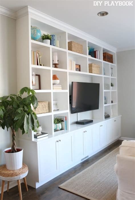 wall units with desk tv and bookshelves casey s family room built in reveal diy playbook