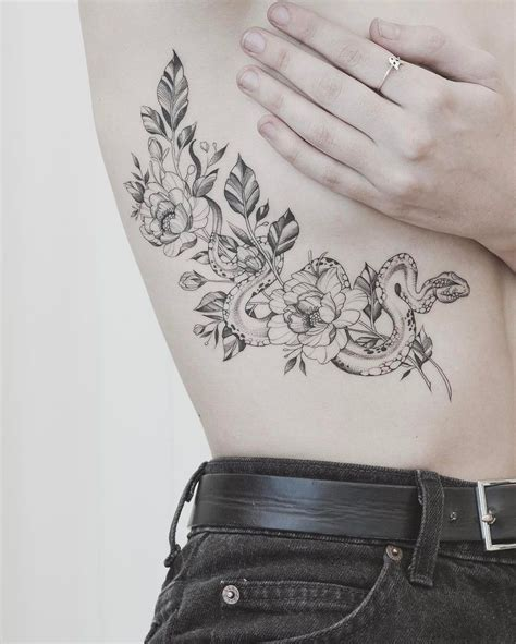 snake tattoo with roses amazing snake meaning and symbolism of snake