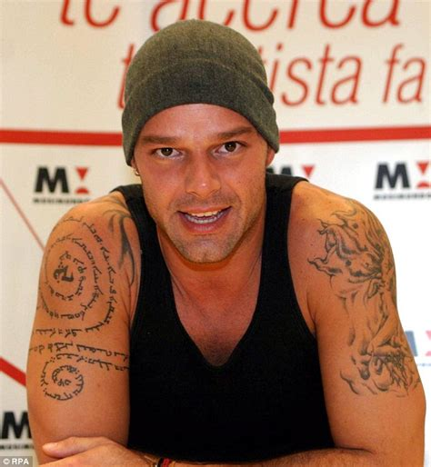 naked women tattoo ricky martin displays sixth on his leg while at