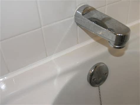 caulking for bathtub what is the difference between grout and caulk