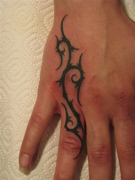 hand tribal tattoo lucky 3 tribal on tattoochief