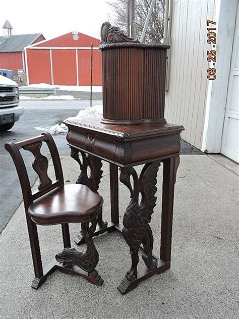 antique telephone table with attached chair antique