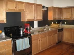 my kitchen with black chalkboard paint on the backsplash