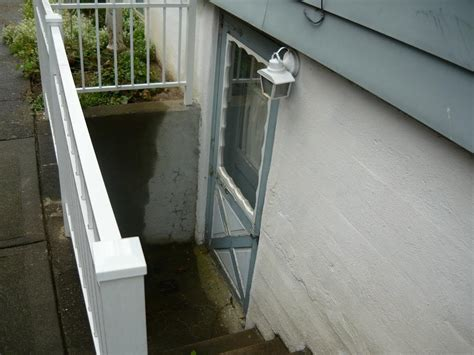 exterior basement entrance drain preventing clogging flooding at bottom of exterior