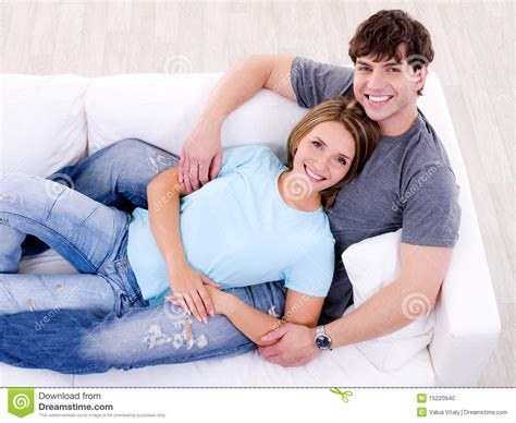 couple on sofa loving couple lying together on the sofa stock photo