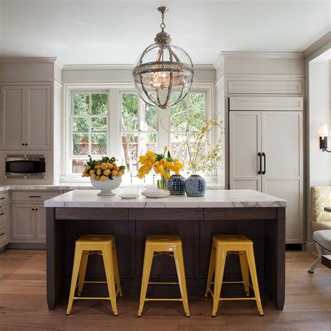 restoration hardware kitchen lighting yellow tolix stools transitional kitchen benjamin