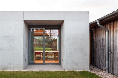 Glass and Concrete Pavilion Extends Timber Paneled Home in