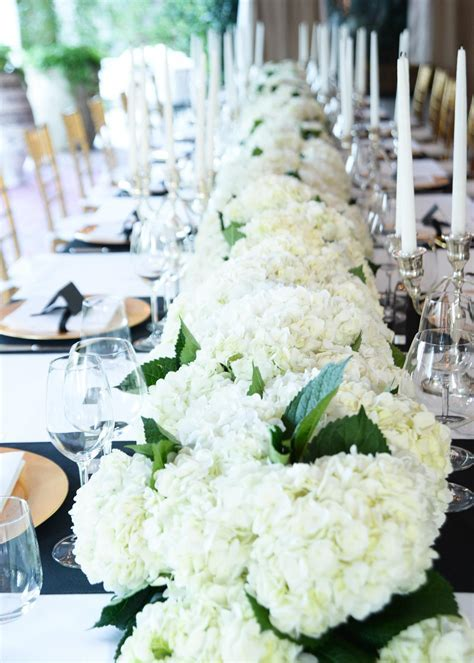 Lots of hydrangea centerpieces that look like one long row