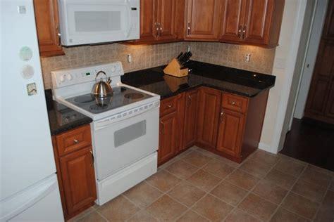 dark brown maple kitchen cabinets save up to 60 on maple cabinets tan brown granite tile blacksplash vinyl