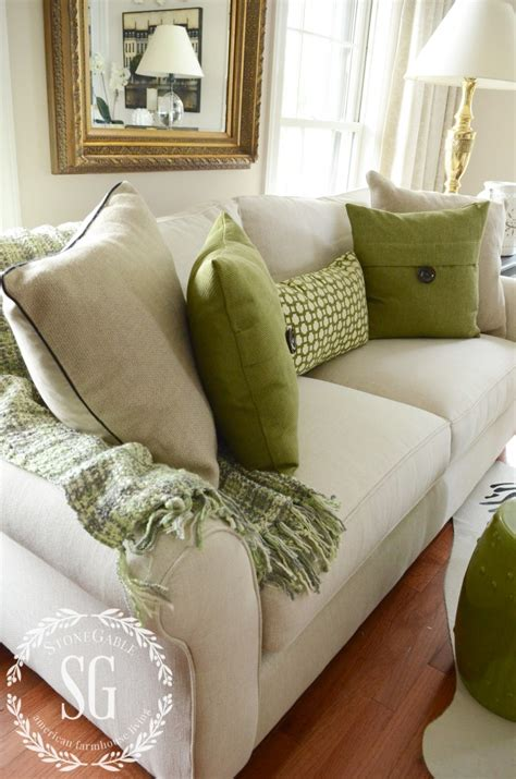 pillow arrangements on sofa neutral and green pillows on a neutral sofa with a green throw
