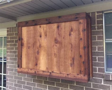 Outdoor TV cabinet made of rough cedar lumber   Cedar