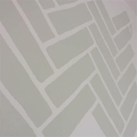 herringbone pattern wall stencils a herringbone brick stenciled laundry room stencil